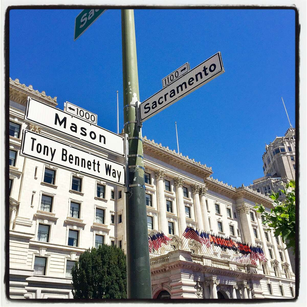 New street signage in front of the Fairmont Hotel honors singer Tony Bennett. June 2, 2018.