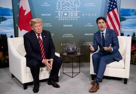 US President Donald Trump and Canadian Prime Minister Justin Trudeau hold a meeting on the sidelines of the G7 Summit in La Malbaie, Quebec, Canada, June 8, 2018. / AFP PHOTO / SAUL LOEBSAUL LOEB/AFP/Getty Images