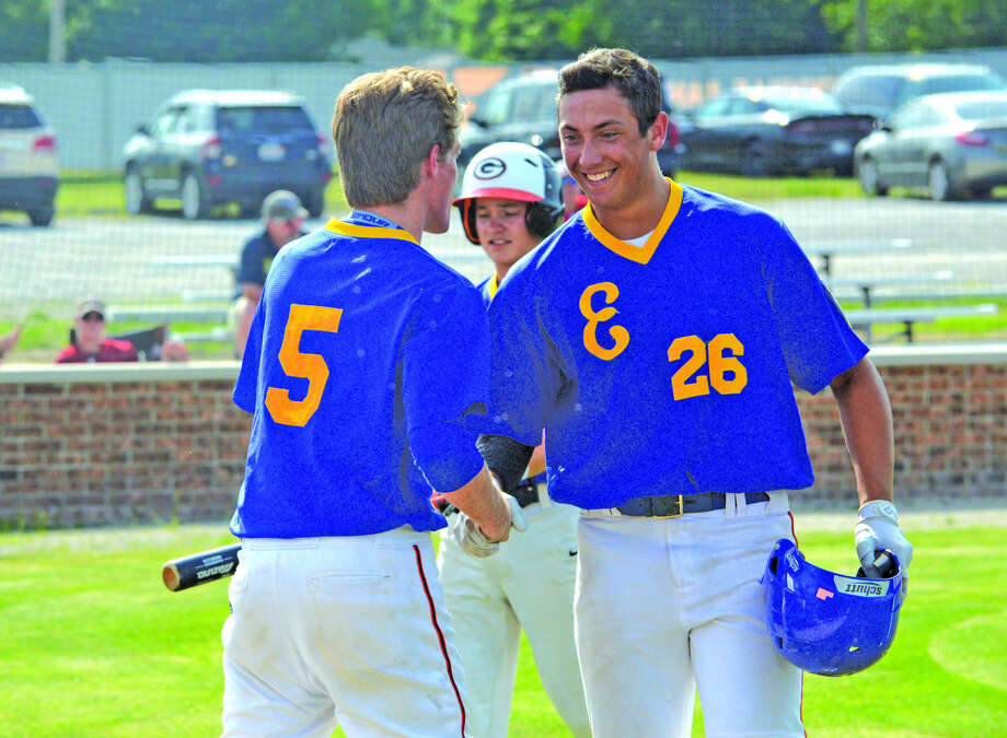 Chase Gockel, right, of the Edwardsville Post 199 Bears is congratulated by teammate Will Messer after hitting a two-run homer against Cumberland on Friday in the Greenville University Wood Bat Classic at Robert E. Smith Field.