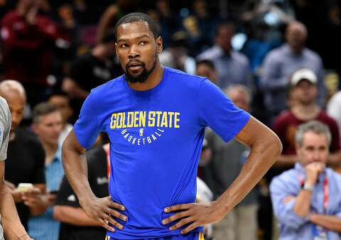 9048b9e399bd Kevin Durant  35 of the Golden State Warriors warms up before Game Four of  the
