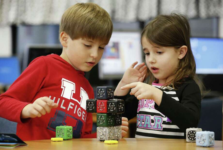 Ed White E-STEM Elementary first-graders build a robot during maker space in the school library  Jan. 24, 2018, in El Lago. STEM education is an immersive experience from the classroom to the lab to the library for students at Clear Creek ISD Ed White Elementary in El Lago. Photo: Steve Gonzales, Houston Chronicle / Houston Chronicle / © 2018 Houston Chronicle