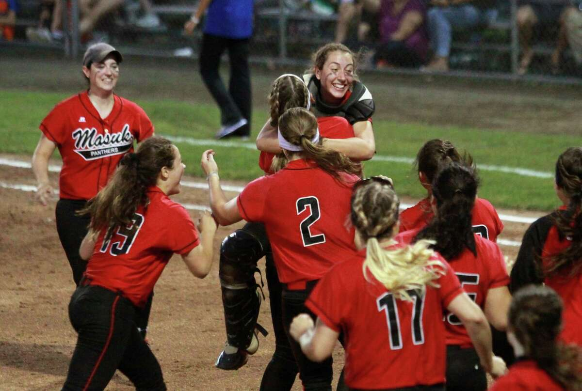 Masuk celebrates its win over Brookfield during the Class L state championship game Friday night in West Haven.