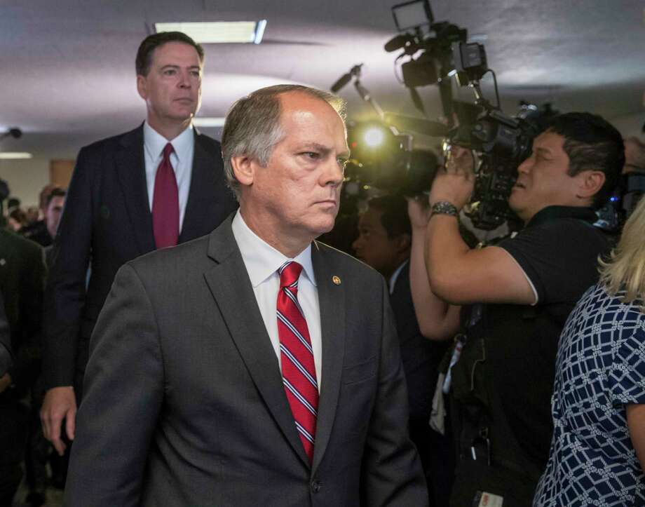 FILE - In this June 8, 2017 file photo, James Wolfe, center, former director of security with the Senate Intelligence Committee, escorts former FBI director James Comey to a secure room to continue his testimony on the 2016 election and his firing by President Donald Trump, on Capitol Hill in Washington. Federal prosecutors are accusing Wolfe with lying to the FBI about contact he had with reporters who covered the committee. (AP Photo/J. Scott Applewhite, file) Photo: J. Scott Applewhite / Copyright 2018 The Associated Press. All rights reserved.