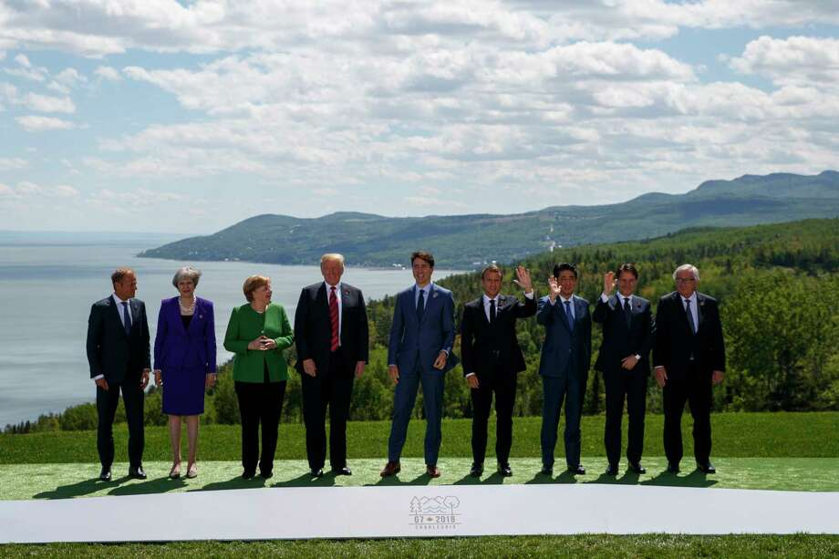 From left, President of the European Council Donald Tusk, British Prime Minister Theresa May, German Chancellor Angela Merkel, U.S. President Donald Trump, Canadian Prime Minister Justin Trudeau, French President Emmanuel Macron, Japanese Prime Minister Shinzo Abe, Italian Prime Minister Giuseppe Conte and President of the European Commission Jean-Claude Juncker gather for the family photo at the G-7 summit, Friday, June 8, 2018, in Charlevoix, Canada. (AP Photo/Evan Vucci) Photo: Evan Vucci / Copyright 2018 The Associated Press. All rights reserved.