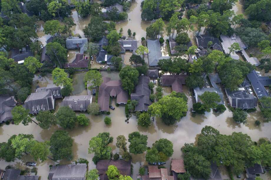 Homes just east of Beltway 8 are inundated with water from the overflowing Buffalo Bayou north of Briar Forest Drive on Sept. 2, 2017, in Houston. Photo: Mark Mulligan, Staff Photographer / Mark Mulligan / Houston Chronicle / 2017 Mark Mulligan / Houston Chronicle