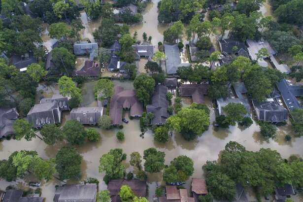 Homes just east of Beltway 8 are inundated with water from the overflowing Buffalo Bayou north of Briar Forest Drive on Sept. 2, 2017, in Houston.