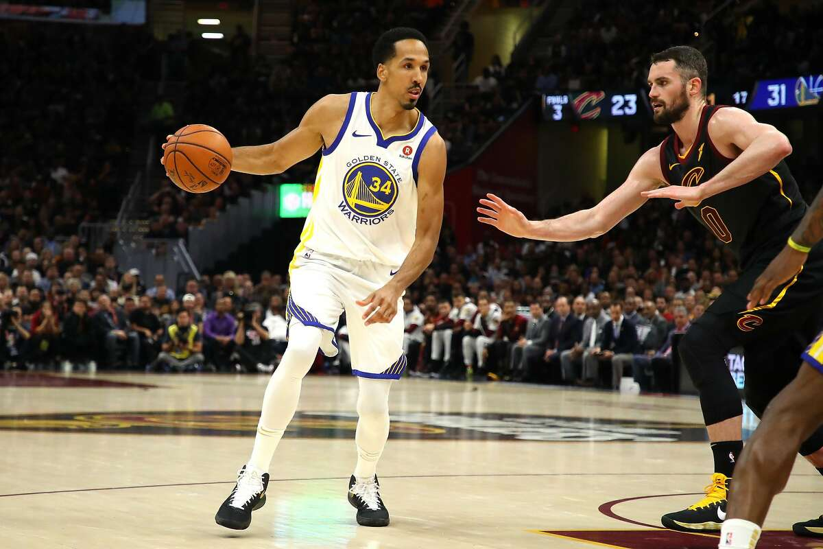 Shaun Livingston #34 of the Golden State Warriors handles the ball against Kevin Love #0 of the Cleveland Cavaliers in the first half during Game Four of the 2018 NBA Finals at Quicken Loans Arena on June 8, 2018 in Cleveland, Ohio.