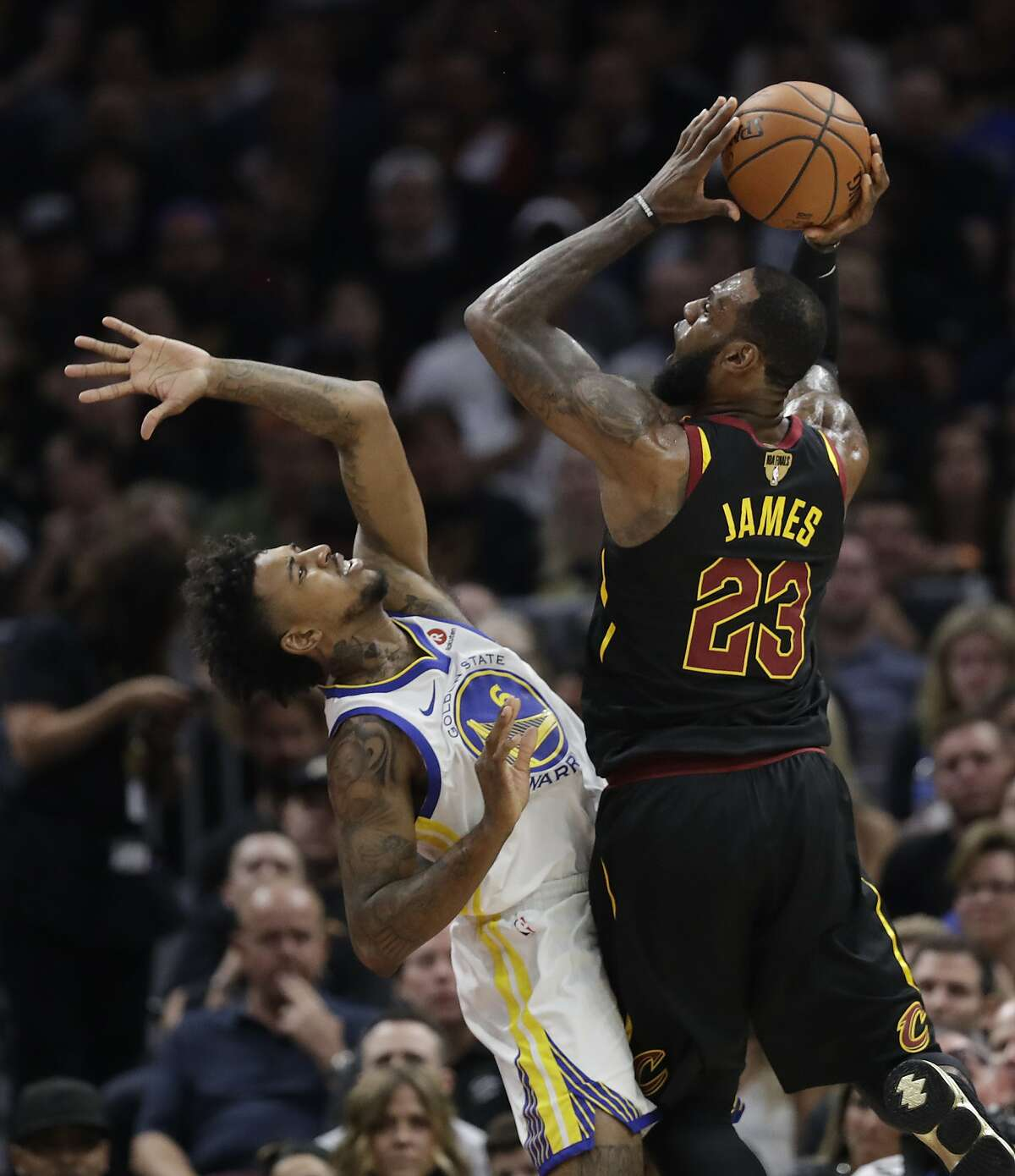 Cleveland Cavaliers' LeBron James shoots over Golden State Warriors' Nick Young during the first half of Game 4 of basketball's NBA Finals, Friday, June 8, 2018, in Cleveland. (AP Photo/Tony Dejak)