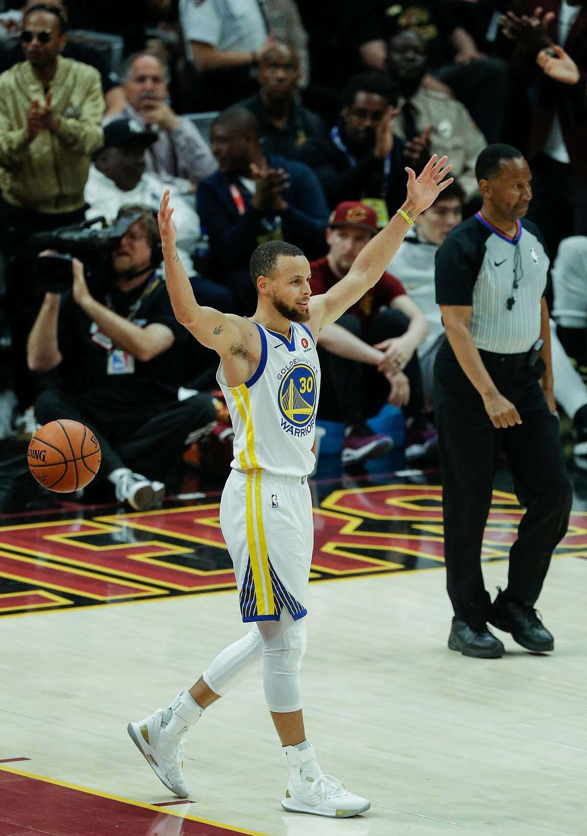 Golden State Warriors' Stephen Curry reacts in the first quarter during game 4 of The NBA Finals between the Golden State Warriors and the Cleveland Cavaliers at Oracle Arena on Friday, June 8, 2018 in Cleveland, Ohio.