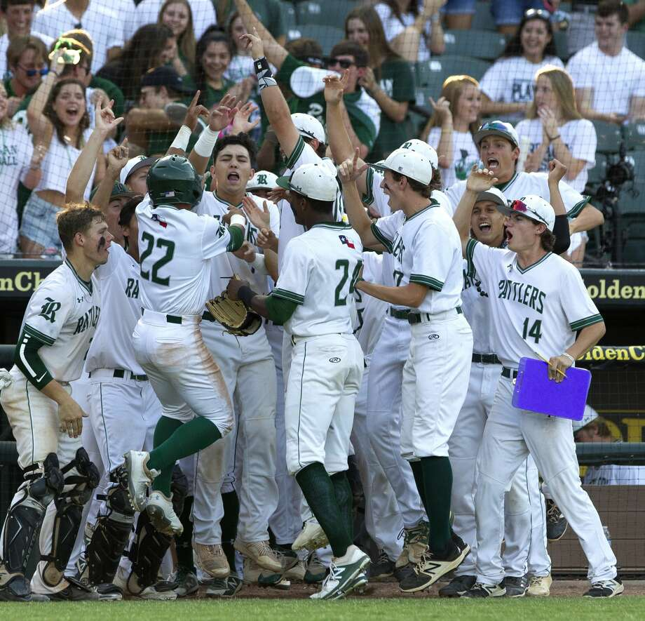 San Antonio Reagan Jared Sherer celebrates with teammates after scoring to tie the game 1-1 in the second inning of a Class 6A state semifinal game during the UIL State Baseball Championships at Dell Diamond on Friday, June 8, 2018, in Round Rock. Reagan went on to score five runs in the inning. Photo: Jason Fochtman/Houston Chronicle