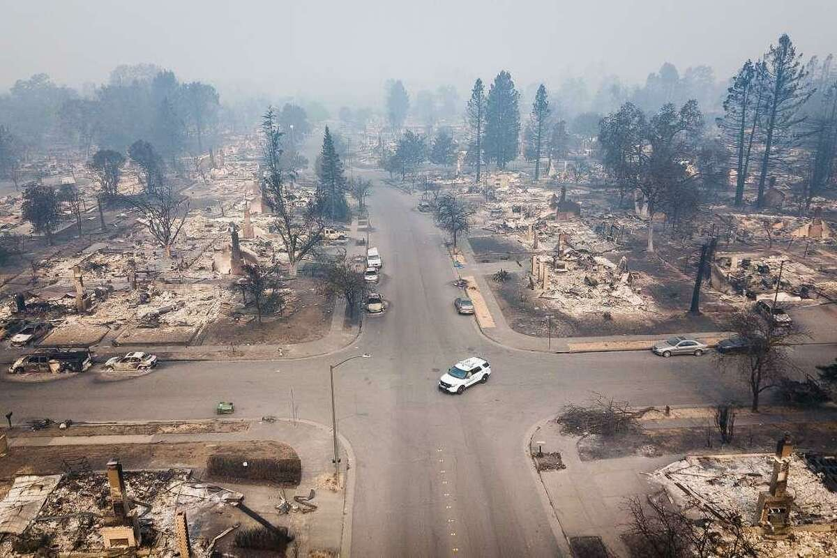 The remains of homes in Santa Rosa's Coffey Park neighborhood after the Tubbs Fire burned through are seen from the air on Tuesday, October 10, 2017.