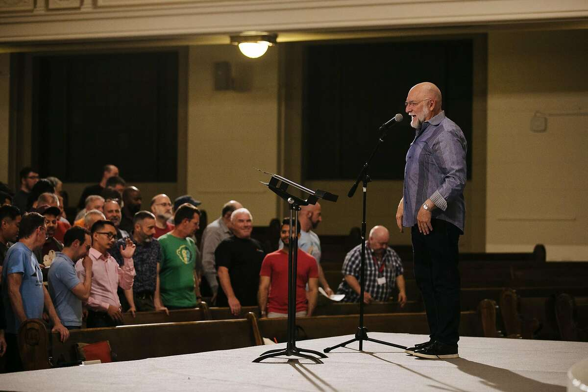 Director and Conductor of the San Francisco Gay Men's Chorus, Tim Seelig, directs the Gay Men's Chorus during a rehearsal at the Academy of Art University in San Francisco, Calif., Monday, June 4, 2018.