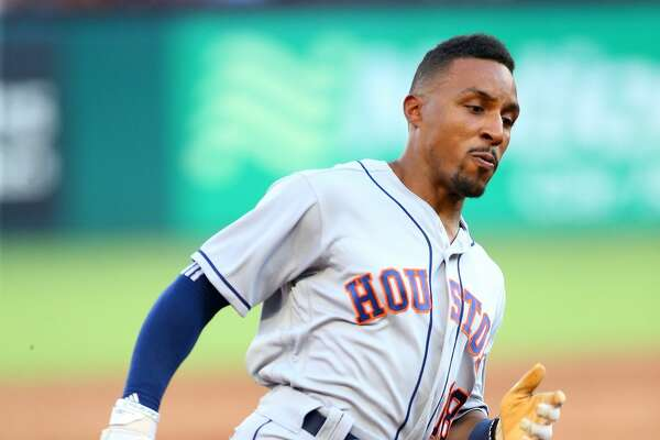 ARLINGTON, TX - JUNE 08: Tony Kemp #18 of the Houston Astros rounds third base to score in the in the second inning against the Texas Rangers at Globe Life Park in Arlington on June 8, 2018 in Arlington, Texas. (Photo by Rick Yeatts/Getty Images)