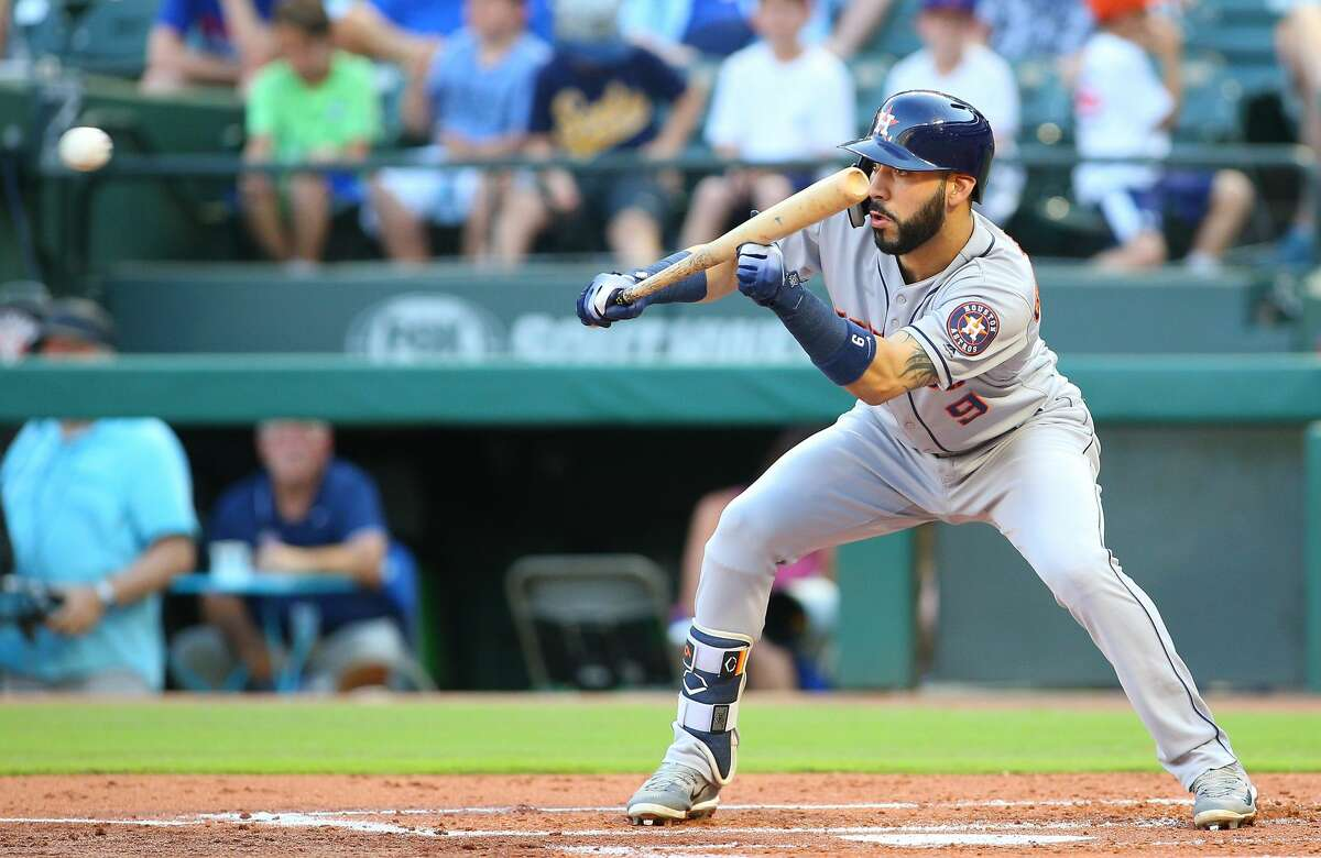 ARLINGTON, TX - JUNE 08: Marwin Gonzalez #9 of the Houston Astros bunts in the second inning against the Texas Rangers at Globe Life Park in Arlington on June 8, 2018 in Arlington, Texas. (Photo by Rick Yeatts/Getty Images)