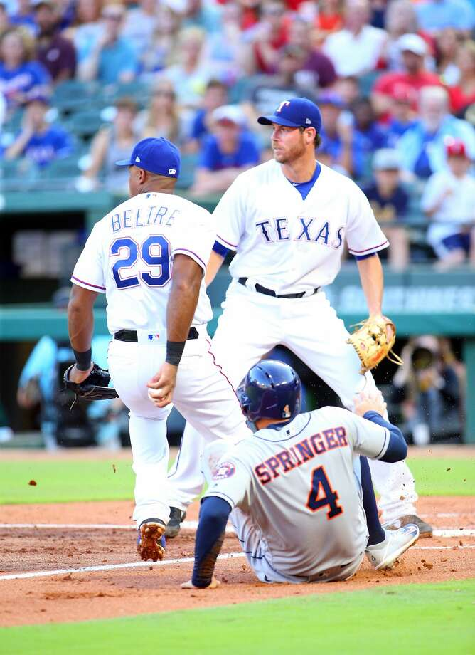 ARLINGTON, TX - JUNE 08: Doug Fister #38 of the Texas Rangers and Adrian Beltre #29 run down George Springer #4 of the Houston Astros for the out at home plate in the second inning at Globe Life Park in Arlington on June 8, 2018 in Arlington, Texas. (Photo by Rick Yeatts/Getty Images) Photo: Rick Yeatts/Getty Images