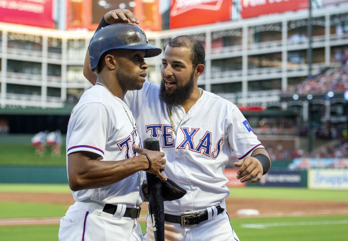 Texas Rangers' Rougned Odor, right, congratulates Delino DeShields after DeShields scored on an double by Nomar Mazara off of Houston Astros starting pitcher Justin Verlander during the third inning of a baseball game, Friday, June 8, 2018, in Arlington, Texas. Shin-Soo Choo also scored on the play. (AP Photo/Jeffrey McWhorter)