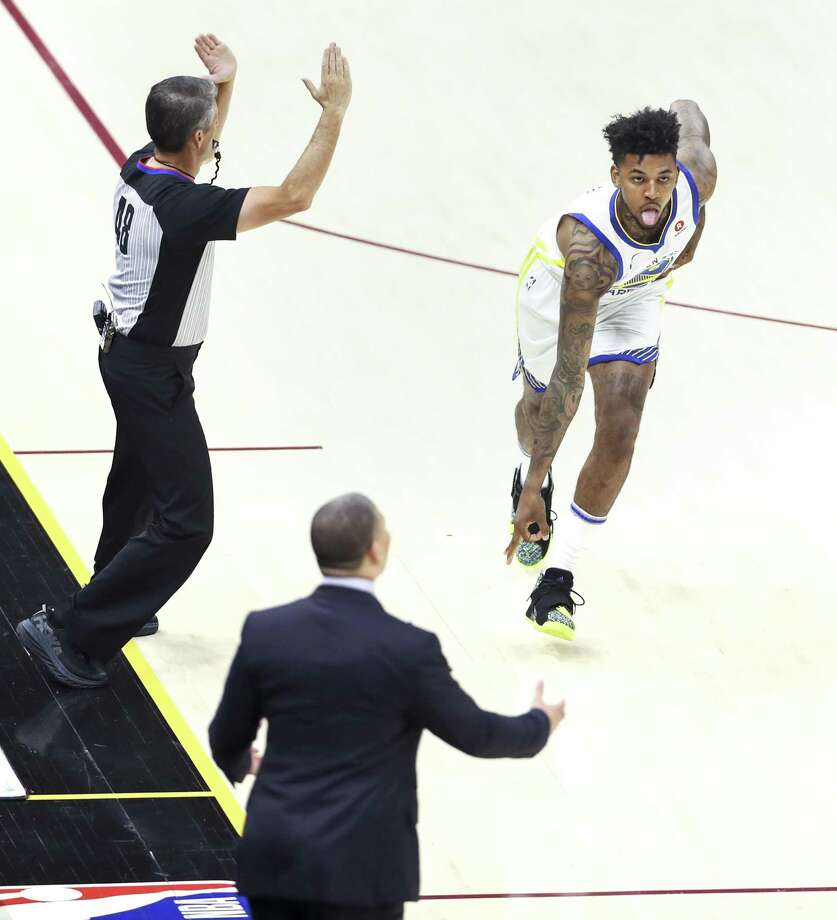 54a0708964e2 Golden State Warriors  Nick Young reacts after hitting a three-pointer in  the first