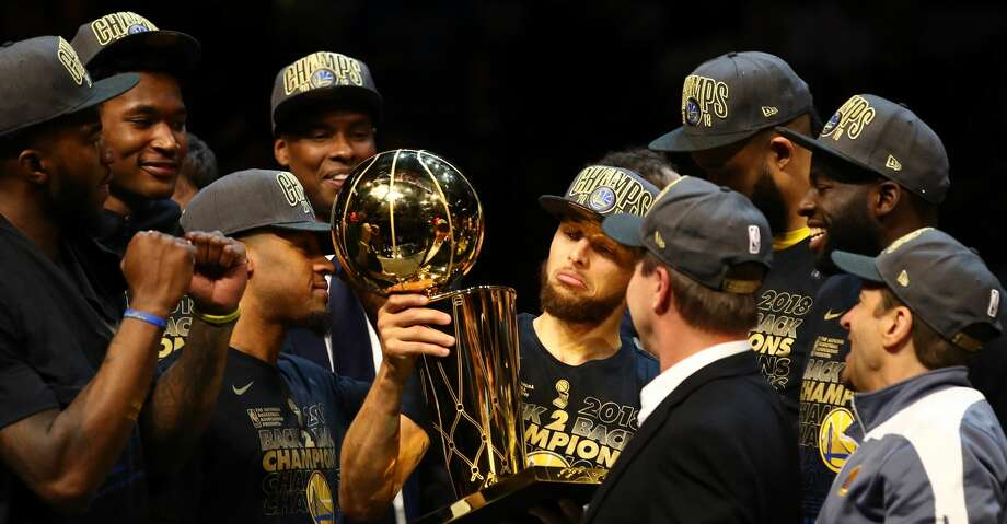 CLEVELAND, OH - JUNE 08:  Stephen Curry #30 of the Golden State Warriors celebrates with the Larry O'Brien Trophy after defeating the Cleveland Cavaliers during Game Four of the 2018 NBA Finals at Quicken Loans Arena on June 8, 2018 in Cleveland, Ohio. The Warriors defeated the Cavaliers 108-85 to win the 2018 NBA Finals. NOTE TO USER: User expressly acknowledges and agrees that, by downloading and or using this photograph, User is consenting to the terms and conditions of the Getty Images License Agreement.  (Photo by Gregory Shamus/Getty Images) Photo: Gregory Shamus/Getty Images