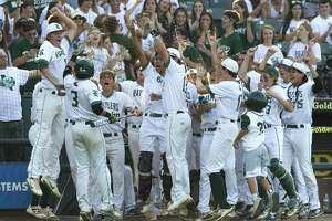 San Antonio Regan players celebrate after Dalton Brieger scored on Seth Morrow's RBI single in the second inning of a Class 6A state semifinal game during the UIL State Baseball Championships at Dell Diamond on Friday, June 8, 2018, in Round Rock.