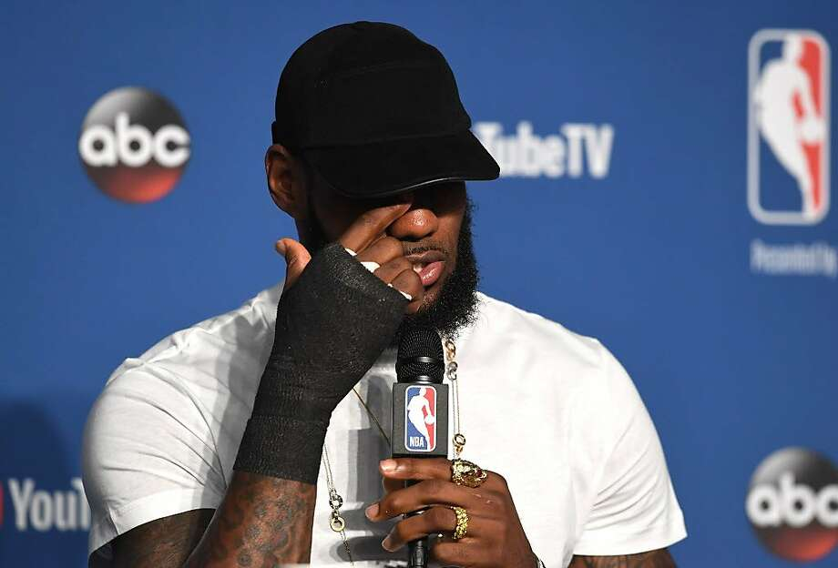 LeBron James of the Cleveland Cavaliers speaks to the media with a cast on his right hand after being defeated by the Golden State Warriors during Game Four of the 2018 NBA Finals at Quicken Loans Arena on June 8, 2018 in Cleveland, Ohio. Photo: Jason Miller, Getty Images