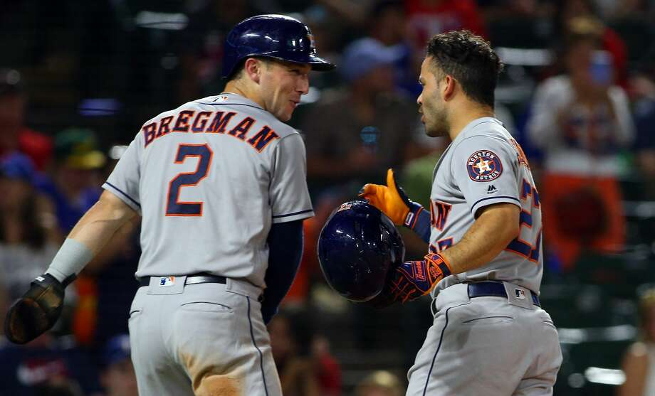 ARLINGTON, TX - JUNE 08: Alex Bregman #2 of the Houston Astros and Jose Altuve #27 celebrate scores in the ring on Altuve two run home run in the seventh inning at Globe Life Park in Arlington on June 8, 2018 in Arlington, Texas. (Photo by Rick Yeatts/Getty Images) Photo: Rick Yeatts/Getty Images