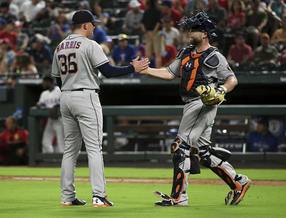 Houston Astros relief pitcher Will Harris (36) is congratulated by catcher Brian McCann after striking out Texas Rangers' Ronald Guzman for the final out of a baseball game Friday, June 8, 2018, in Arlington, Texas. Houston won 7-3. (AP Photo/Jeffrey McWhorter) Photo: Jeffrey McWhorter/Associated Press