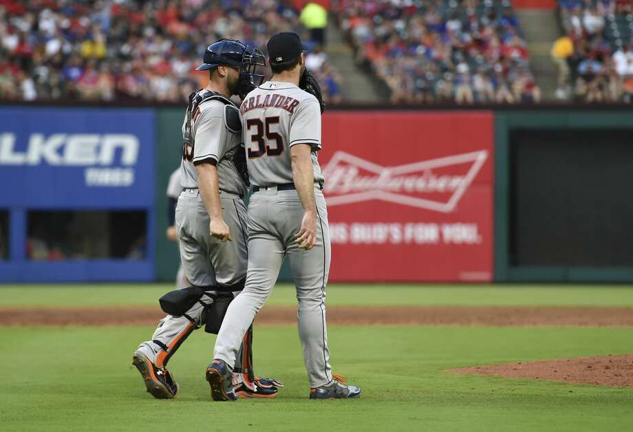 Houston Astros catcher Brian McCann, left, talks to starting pitcher Justin Verlander (35) during the third inning of a baseball game against the Texas Rangers on Friday, June 8, 2018, in Arlington, Texas. Houston won 7-3. (AP Photo/Jeffrey McWhorter) Photo: Jeffrey McWhorter/Associated Press