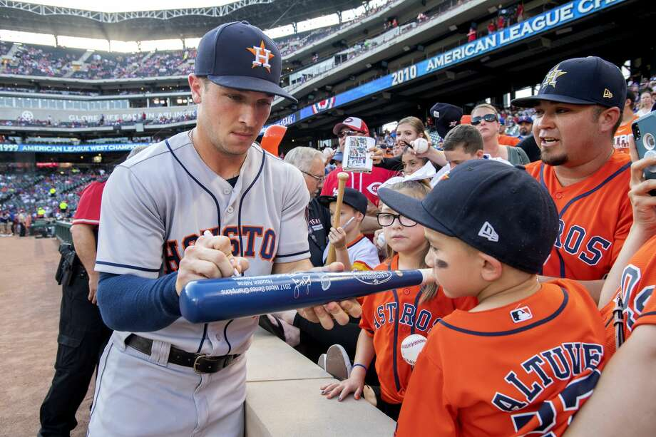 Houston Astros' Alex Bregman signs autographs before a baseball game against the Texas Rangers, Friday, June 8, 2018, in Arlington, Texas. Houston won 7-3. (AP Photo/Jeffrey McWhorter) Photo: Jeffrey McWhorter/Associated Press