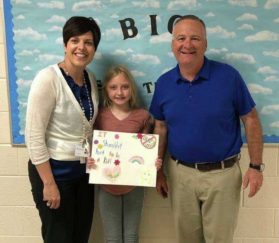 Pictured are Amy Dumaw, program educator of Sanilac County Child Abuse Prevention Council, Elizabeth Kelly and Brian Jones, school counselor. (Submitted Photo)
