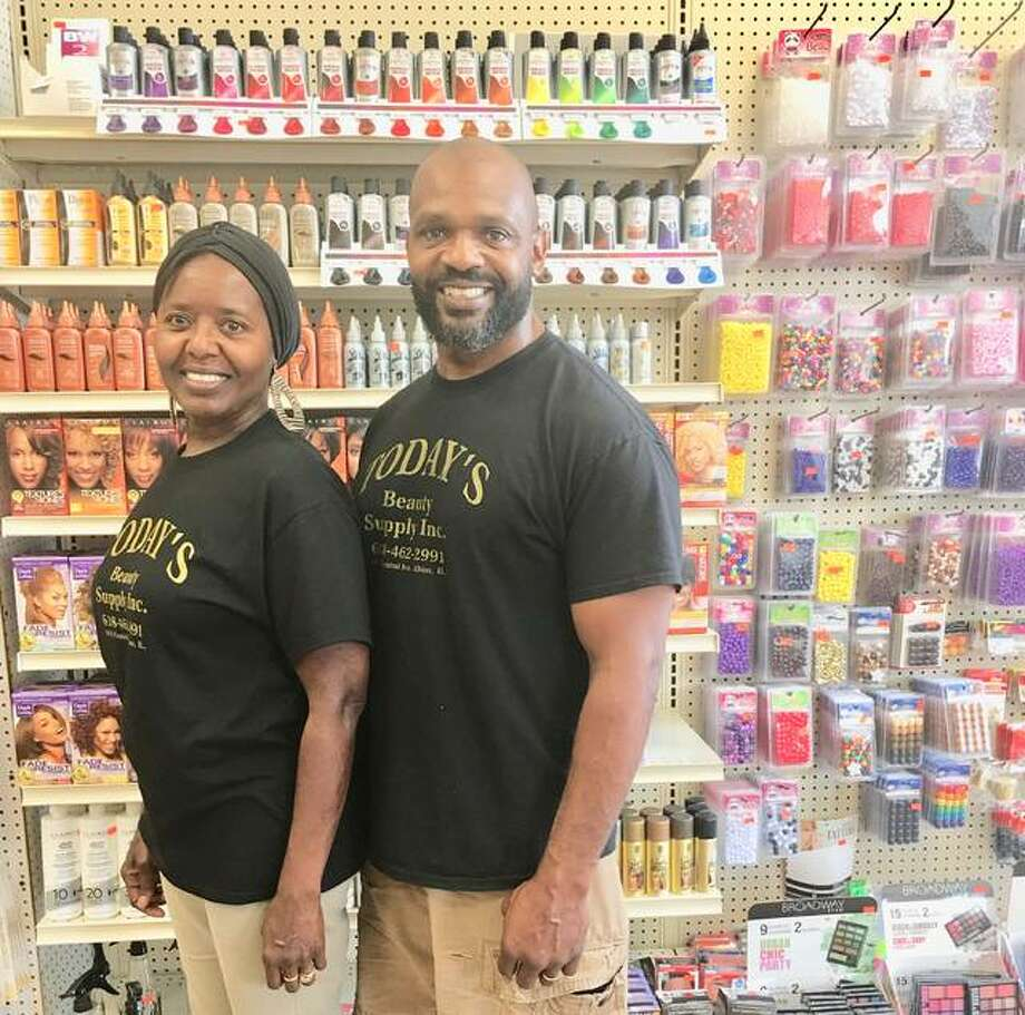 Today's Beauty Supply retail store owner Ben Golley stands with his sister, Angela (Golley) Grubb, at the store she helps him operate. Grubb is the day-to-day face of the retail store, though Golley is there almost daily. Photo:     Jill Moon|The Telegraph