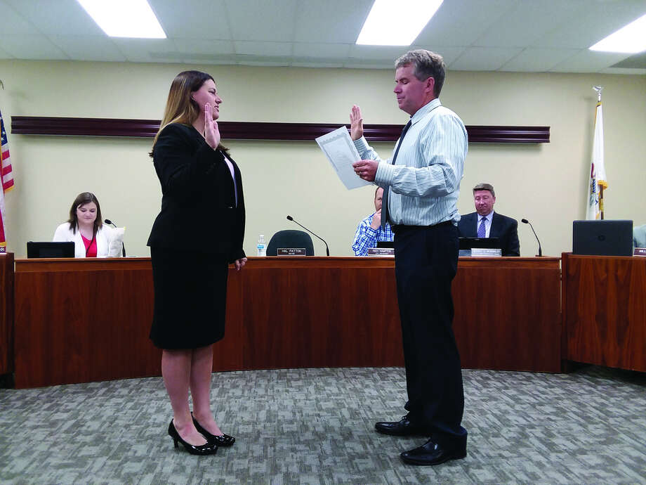 Jeannee Wojcieszak, left, is sworn in as the city clerk/collector by Edwardsville Mayor Hal Patton during Tuesday's meeting at City Hall.