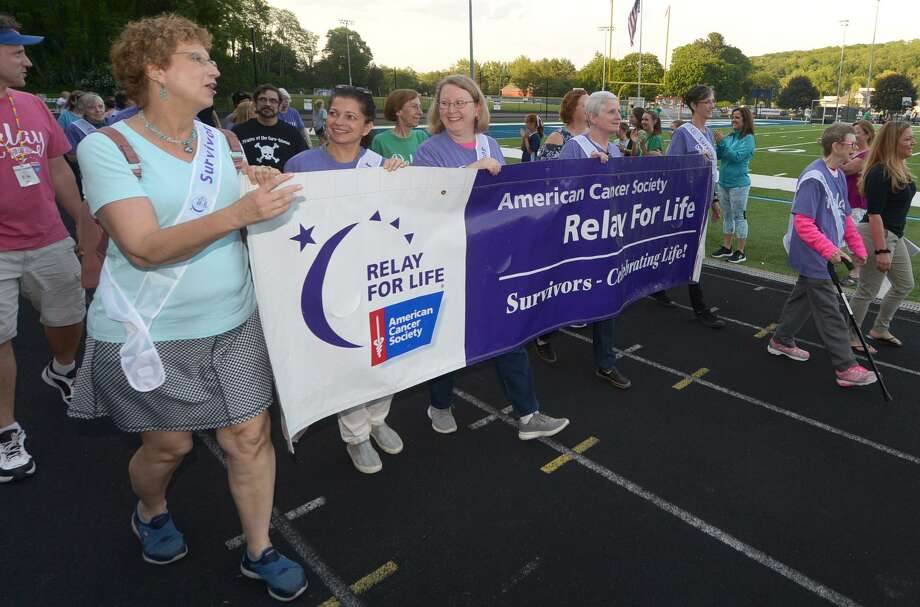 Cancer survivors lead the Wilton Relay for Life following the Opening Ceremony  Friday, June 8, 2018, at Wilton High School in Wilton, Conn. Relay For Life is the signature fundraiser for the American Cancer Society. Relay is staffed and coordinated by volunteers in thousands of communities and 27 countries. Photo: Erik Trautmann / Hearst Connecticut Media / Norwalk Hour