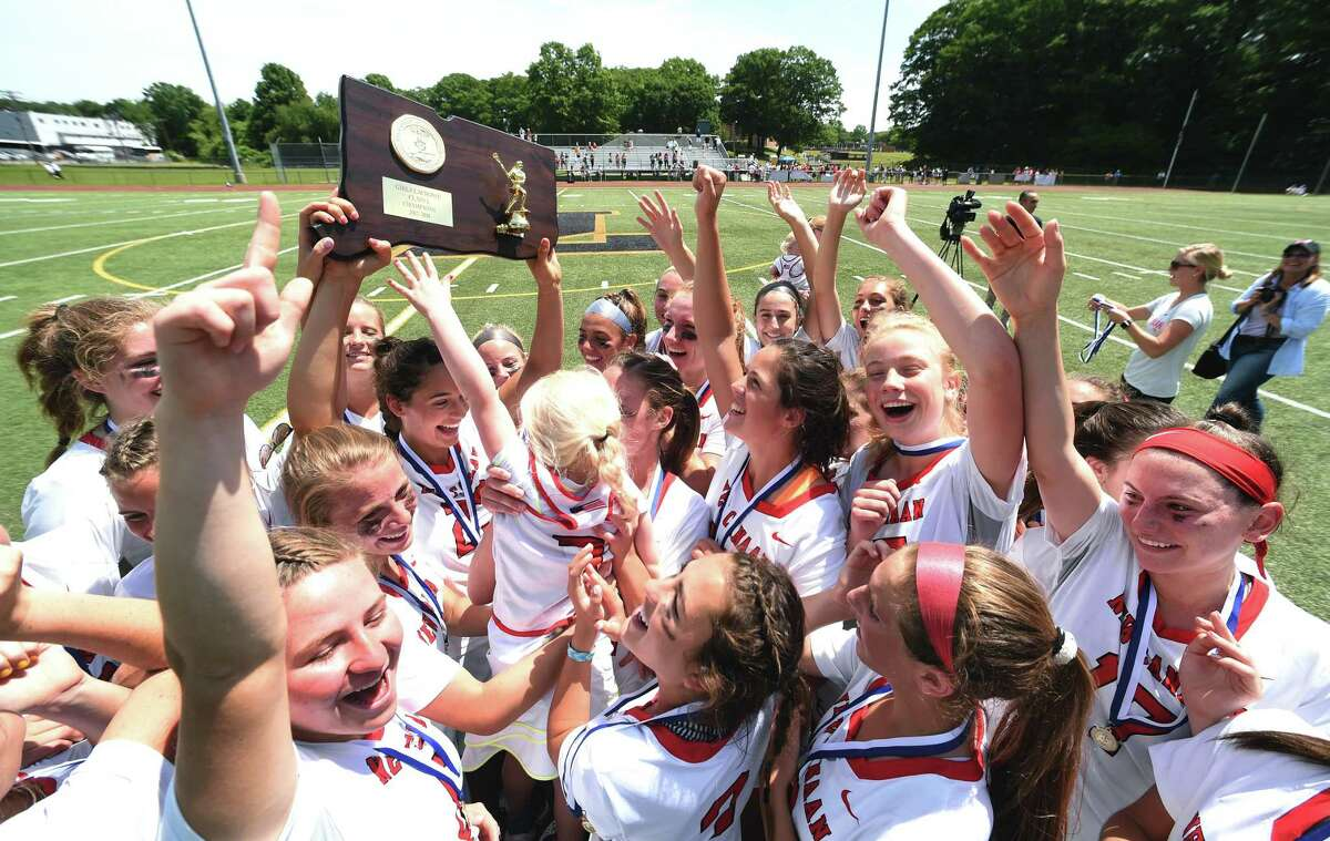 New Canaan celebrates their 19-7 victory over Ridgefield in the CIAC Class L Girls Lacrosse Finals at Jonathan Law High School in Milford on June 9, 2018.