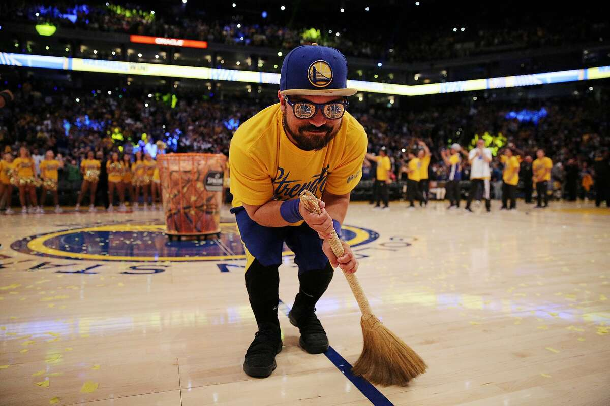 GS Breakers sweep the floor after the end of the NBA Finals during a Golden State Warriors watch party at Oracle Arena, Friday, June 8, 2018, in Oakland, Calif. Visitors watched on the jumbotron Game 4 of the NBA Finals between the Warriors and Cleveland Cavaliers.