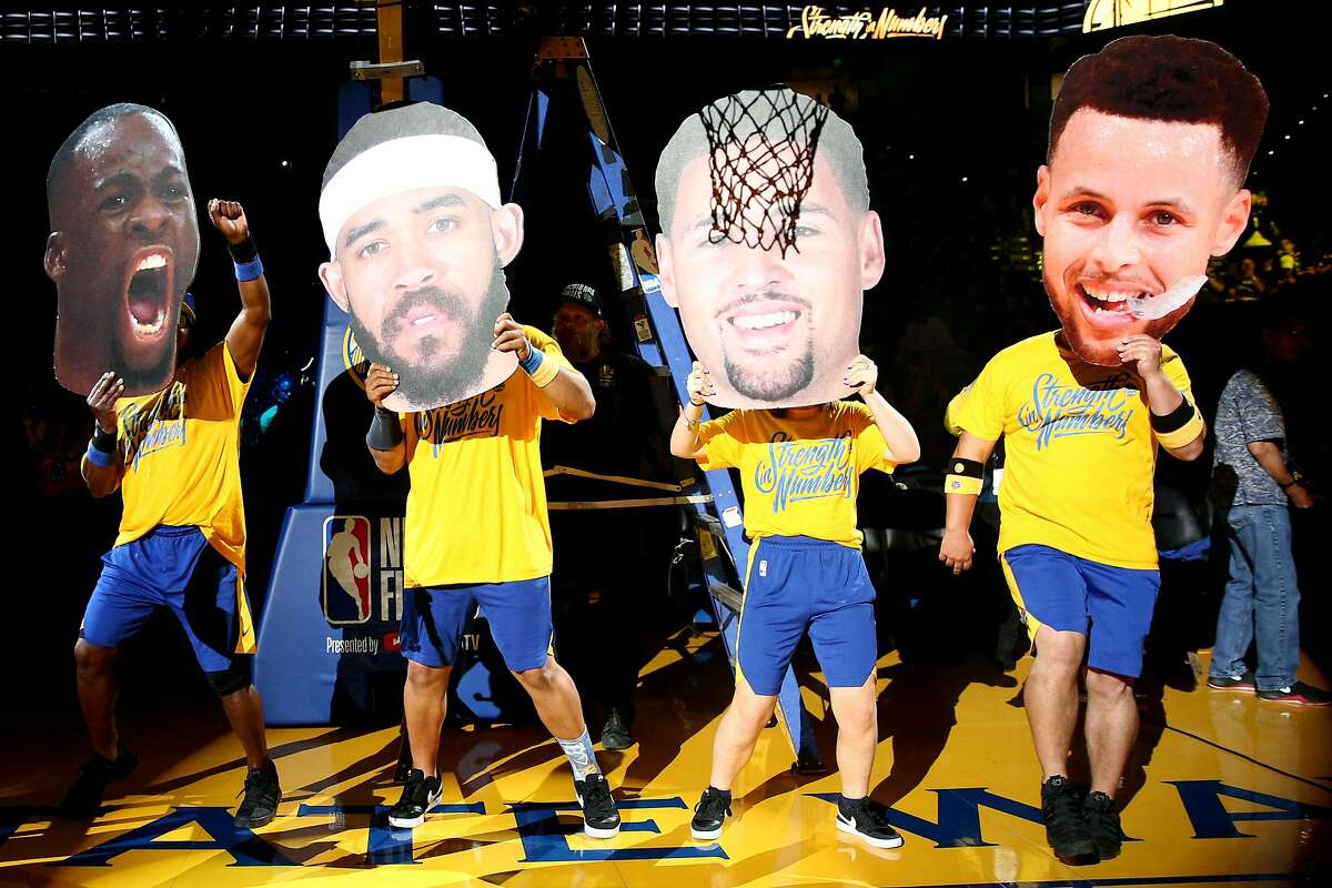 Cutouts of the starting Golden State Warriors team, as the actual players are introduced in Ohio, during a watch party at Oracle Arena, Friday, June 8, 2018, in Oakland, Calif. Visitors watched on the jumbotron Game 4 of the NBA Finals between the Warriors and Cleveland Cavaliers.