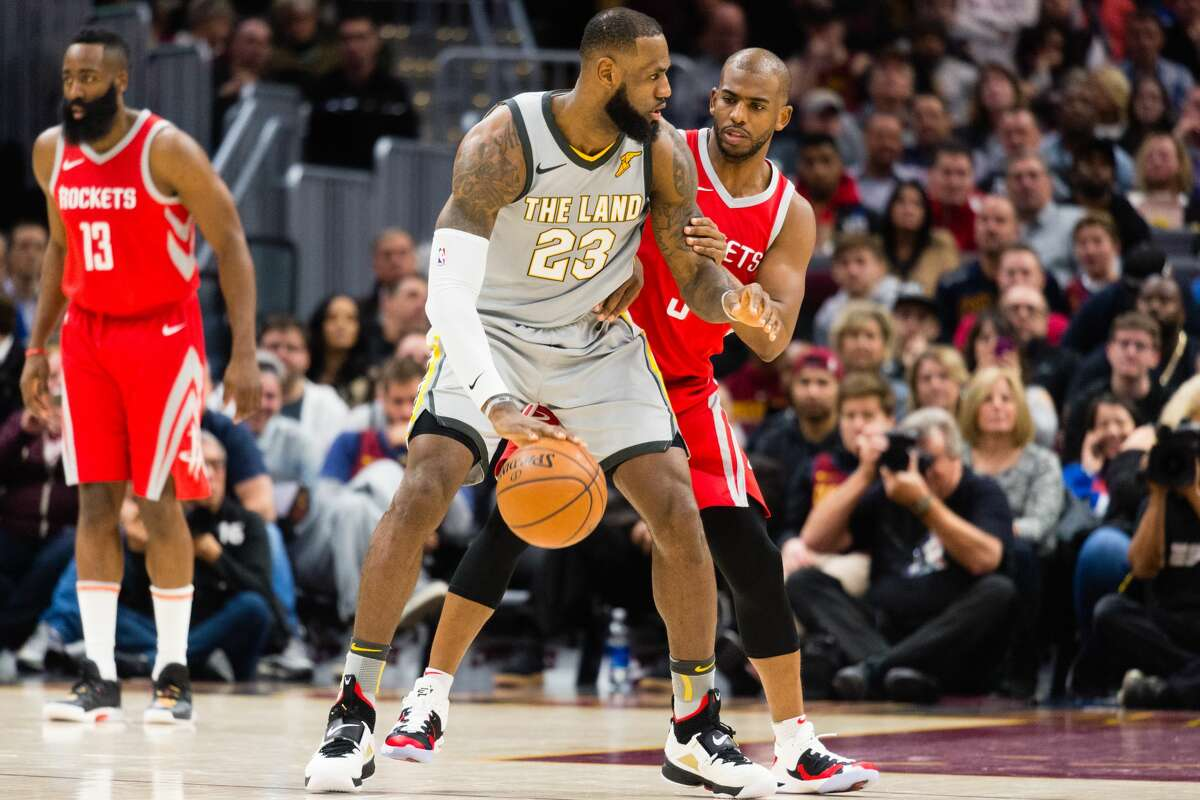 CLEVELAND, OH - FEBRUARY 3: LeBron James #23 of the Cleveland Cavaliers tries to drive around Chris Paul #3 of the Houston Rockets during the first half at Quicken Loans Arena on February 3, 2018 in Cleveland, Ohio. (Photo by Jason Miller/Getty Images)