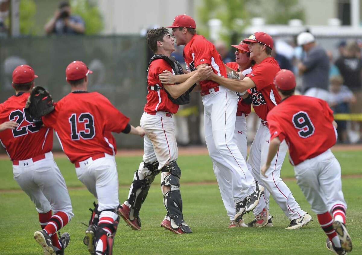 Cheshire pitcher Ben DeLaubell (11) celebrates with catcher Matt Costello following the Rams 1-0 win over Ridgefield in the CIAC Class LL baseball finals at Palmer Field Stadium on June 9, 2018 in Middletown, Connecticut. Cheshire defeated Ridgefield 1-0.