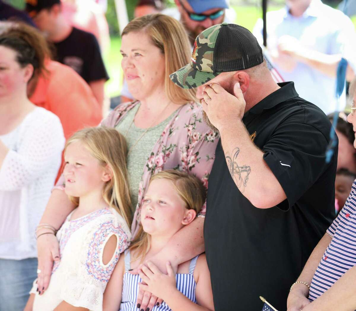 Army veteran John Kadleck, accompanied by his wife Erin, and their three children, becomes emotional during the Operation Finally Home house unveiling on Friday, June 8, 2018, in The Woodlands.