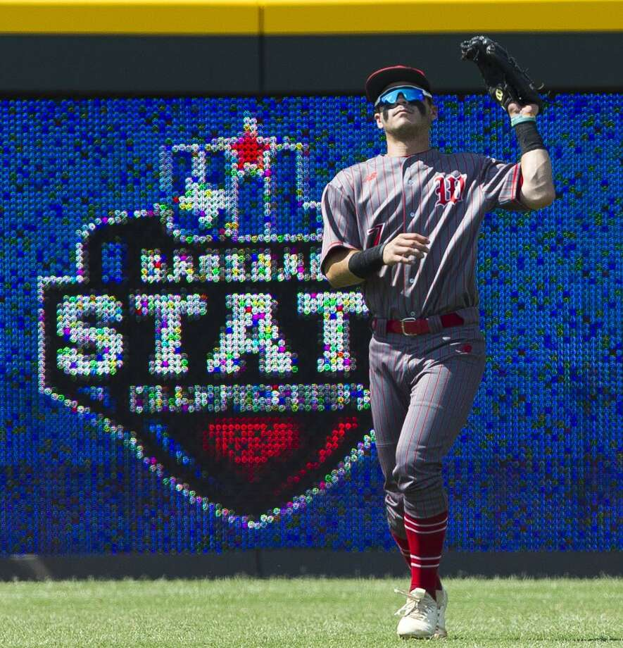 The Woodlands left fielder Zayne Watson (7) fields a fly ball by Nik Millsap #32 of Southlake Carroll in the first inning of a Class 6A state semifinal game during the UIL State Baseball Championships at Dell Diamond on Friday, June 8, 2018, in Round Rock. Photo: Jason Fochtman, Staff Photographer / Houston Chronicle / © 2018 Houston Chronicle