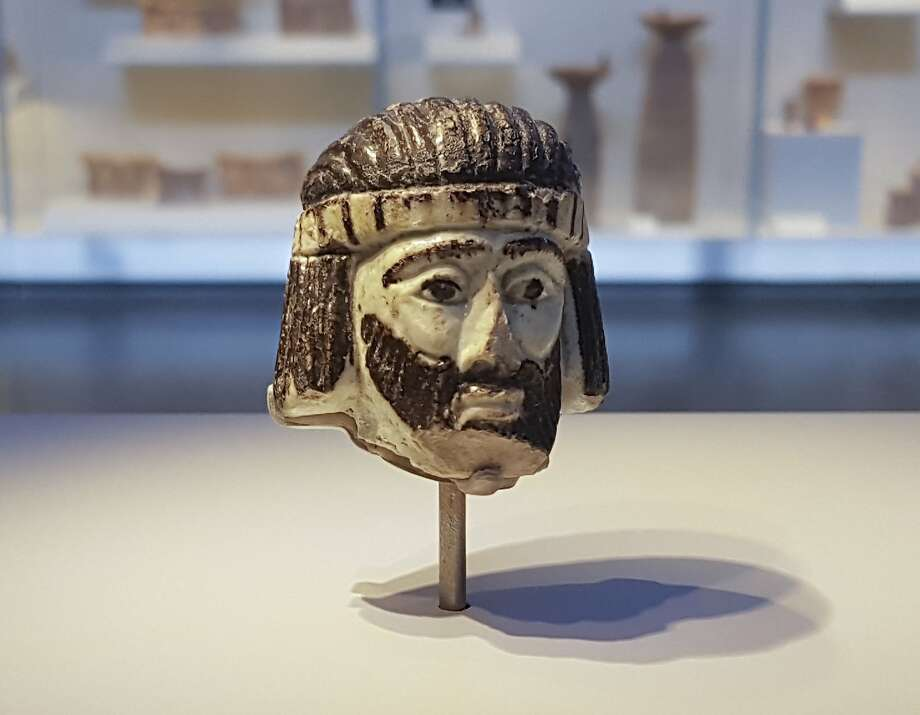 This Monday, June 4, 2018 photo shows a detailed figurine of a king's head on display at the Israel Museum, dating to biblical times, and found last year near Israel's northern border with Lebanon, in Jerusalem. A palm-sized enigmatic sculpture of a king's head dating back nearly 3,000 years has set off a modern-day mystery caper as scholars try to figure out whose face it depicts. The 5-centimeter (2-inch) head is an exceedingly rare example of figurative art from the Holy Land during the 9th century BC,  a period associated with biblical kings. (AP Photo/Ilan Ben Zion) Photo: Ilan Ben Zion, Associated Press
