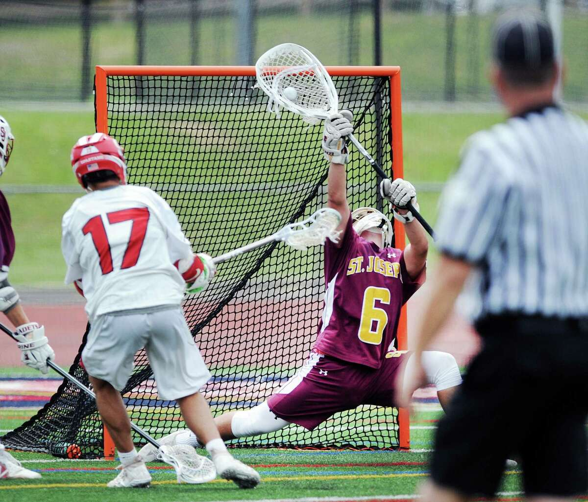 St. Joe's goalie Kyle Burbank (#6) stops a point-blank shot by Dante Giachello (#17) of Somers during the boys high school lacrosse Class S title game between St. Joseph High School and Somers High School at Brien McMahon High School in Norwalk, Conn., Saturday, June 9, 2018. St. Joe's captured the titled beating Somers 11-6, winning their 5th state title in 10 years.