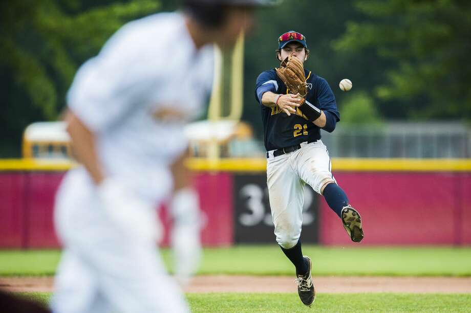 Midland senior Martin Money throws the ball to first during the Chemics' Division 1 regional final against Davison on Saturday, June 9, 2018 at Saginaw Valley State University. (Katy Kildee/kkildee@mdn.net) Photo: (Katy Kildee/kkildee@mdn.net)