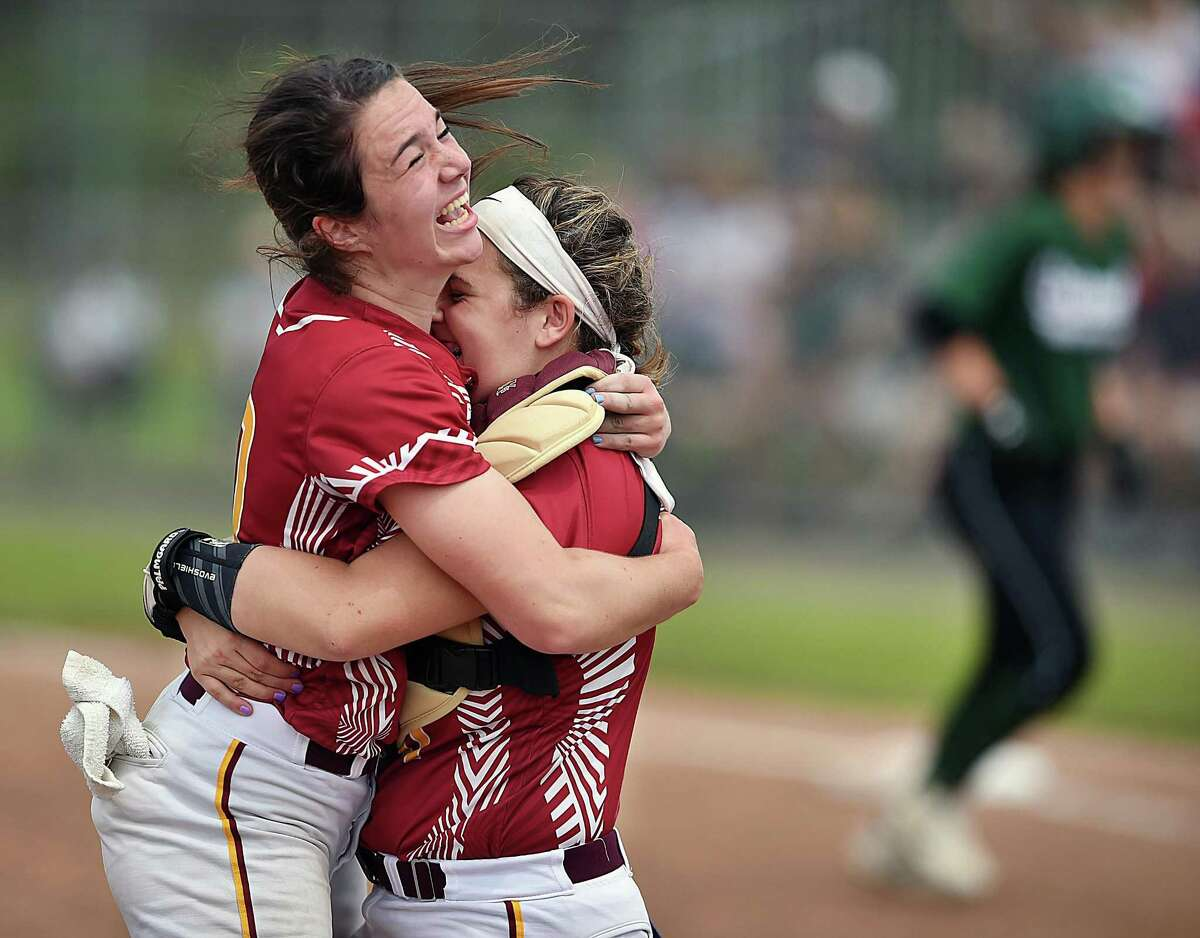 St. Joseph sophomore pitcher Payton Doiron and catcher Charlee Horton celebrate after their 5-2 win over Griswold to win the Class M state softball championship, Saturday, June 9, 2018, at West Haven High School.