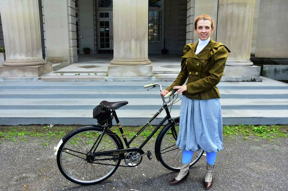 Kjirsten Gustavson, a museum educator with the state parks department, wears a costume similar to what women would have worn while bicycliing in the 1890s, when the popularity of bikes exploded and gave women a new kind of independence. Gustavson gave a talk on the subject and led a ride through the Saratiga SPa State Park on Saturday, June 24, 2017. (Photo by Steve Barnes/Times Union.)