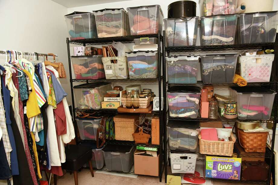 Clothing is seen on a rack and in bins in Justine Carrol's home on Wednesday, June 6, 2018 in Mechanicville, N.Y. She sells the clothing on Etsy. (Lori Van Buren/Times Union) Photo: Lori Van Buren / 20044012A