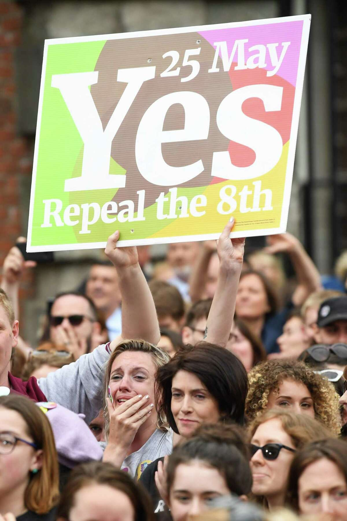 """Supporters celebrate at Dublin Castle after a May 26 referendum on Ireland's strict abortion laws overturned the ban on terminating a pregnancy by 66 percent to 34 percent, which supporters called a """"resounding"""" victory for the yes campaign."""