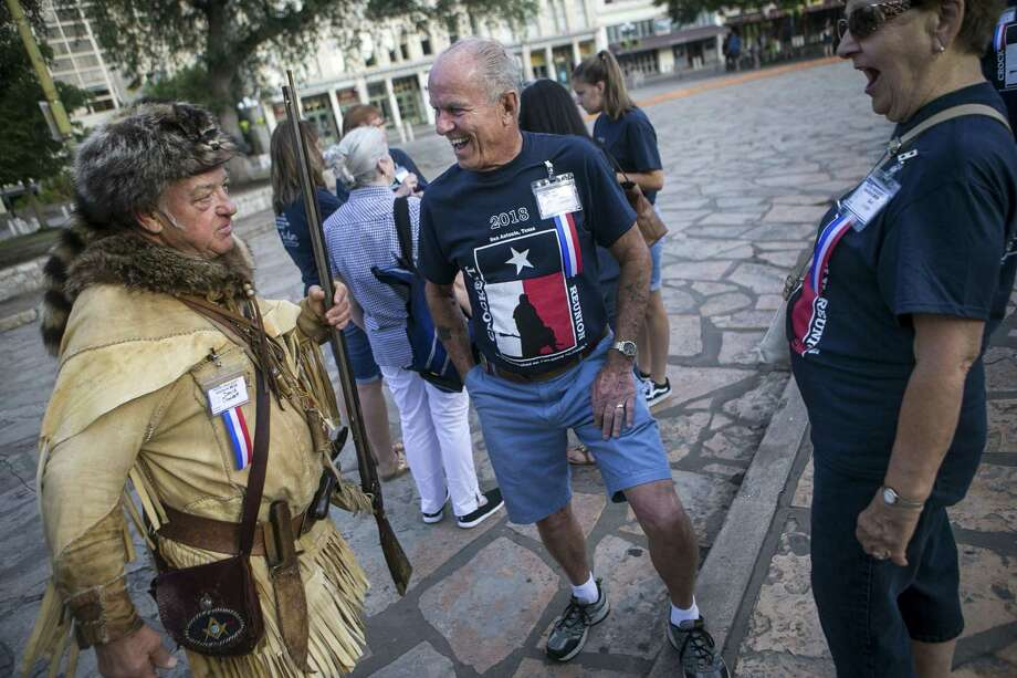 Dave Crockett, center, laughs at a joke David Crockett, left, made at the Alamo in San Antonio June 8, 2018. More than 150 members of the Direct Descendants and Kin of David Crockett gathered in San Antonio to honor the memory and celebrate the life of the famous David Crockett, who died defending the Alamo in 1836. Photo: Josie Norris /San Antonio Express-News / © San Antonio Express-News