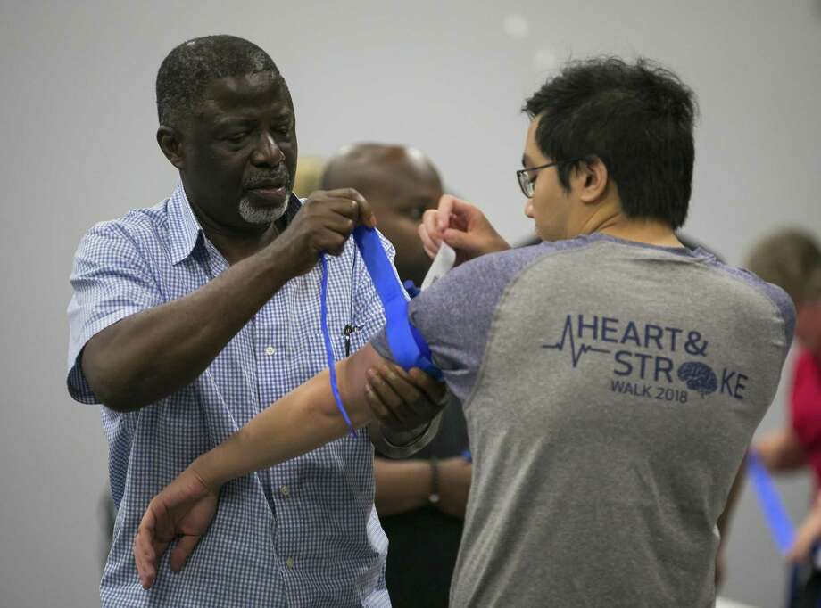Architect and Houston resident Ralph Egbuonu practices applying a tourniquet at Stop the Bleed, a free tourniquet/bleeding control training for the public in Sugar Land on Saturday, June 9, 2018. Egbuonu often travels to Africa for work and hope he can use this training when faced with accidents abroad. Participants received training on how to control life- and limb-threatening blood loss until a person can get treatment at a hospital. (Annie Mulligan / For the Houston Chronicle) Photo: Annie Mulligan, Freelance / Annie Mulligan / @ 2018 Annie Mulligan