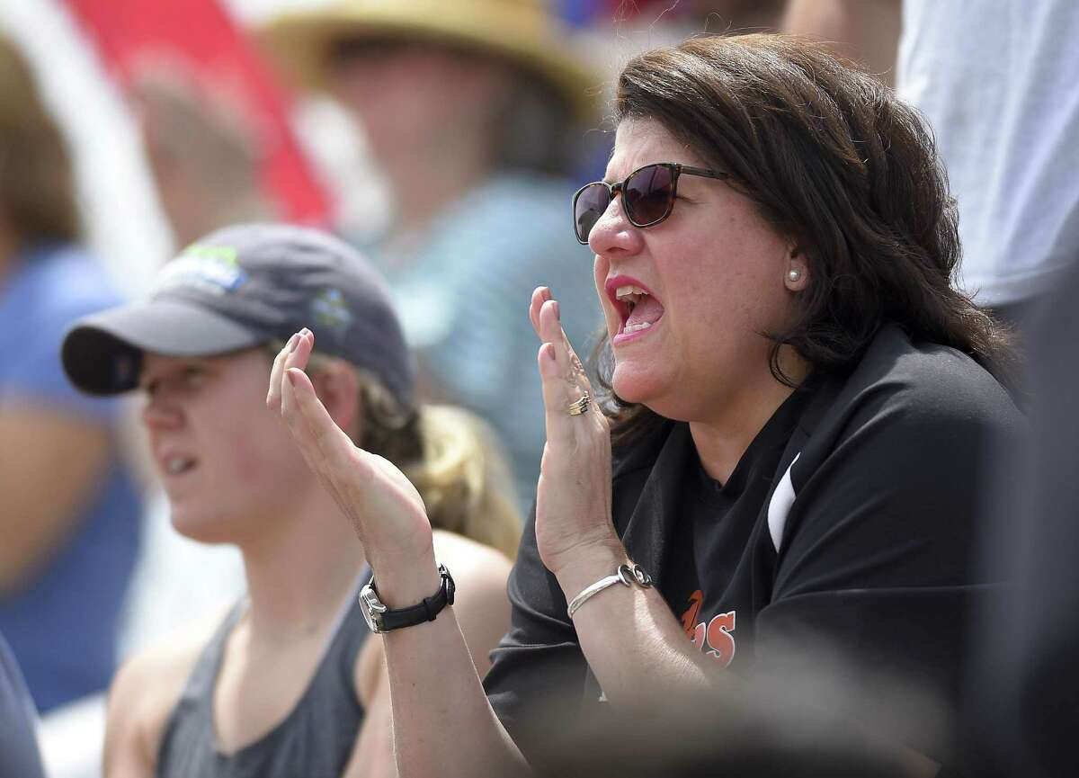 Tricia Fabbri, Quinnipiac women's basketball coach and the wife of Ridgefield's baseball coach Paul Fabbri shows her support for her husbands team during the Class LL baseball finals Saturday against Cheshire at Palmer Field Stadium in Middletown.