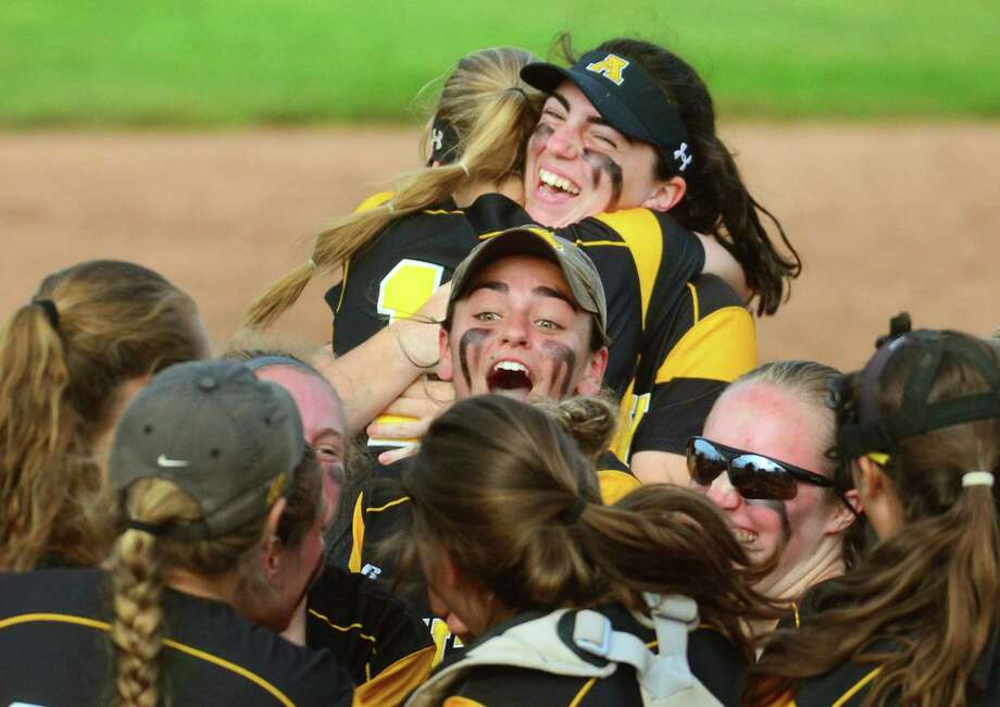Amity celebrates its win over Trumbull in the Class title game on Saturday, Photo: Christian Abraham / Hearst Connecticut Media / Connecticut Post